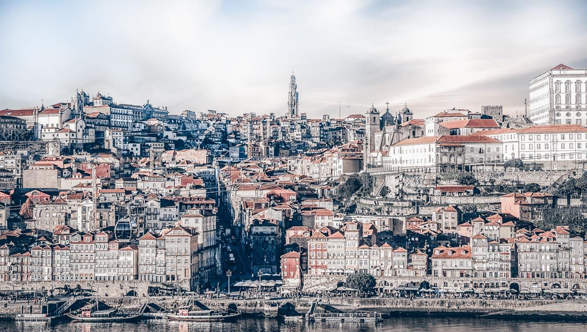 One Day in Porto: The picturesque Ribeira district with the Clerigos Tower in the background