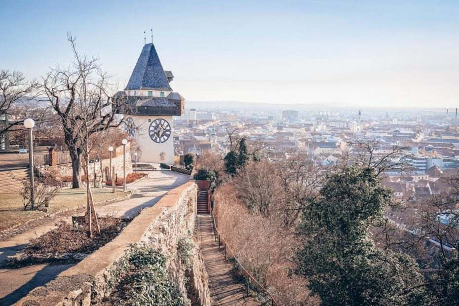 Things to do in Graz: View of the Graz Clock Tower and the city from Schlossberg