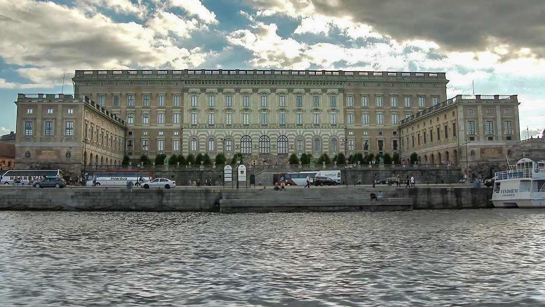 Weekend Guide to Stockholm: The Royal Palace in Stockholm as it overlooks one of the city's canals.