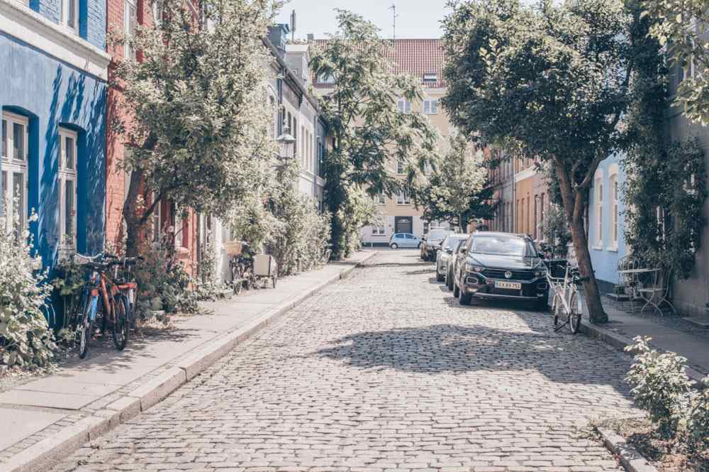 3 Days in Copenhagen: Cars parked on a quiet, cobbled street in the center.