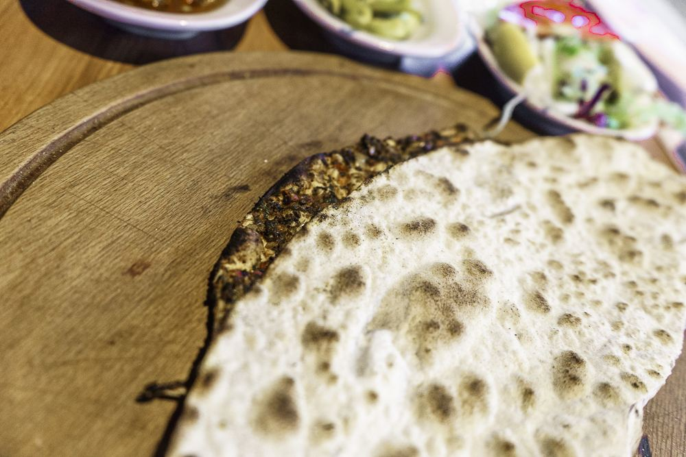 Lahmacun, also known as Turkish pizza, is a cheap and filling street food in Istanbul.