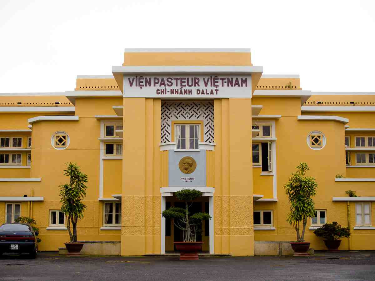 A fresh yellow building in the French Colonial architectural style in Vietnam.