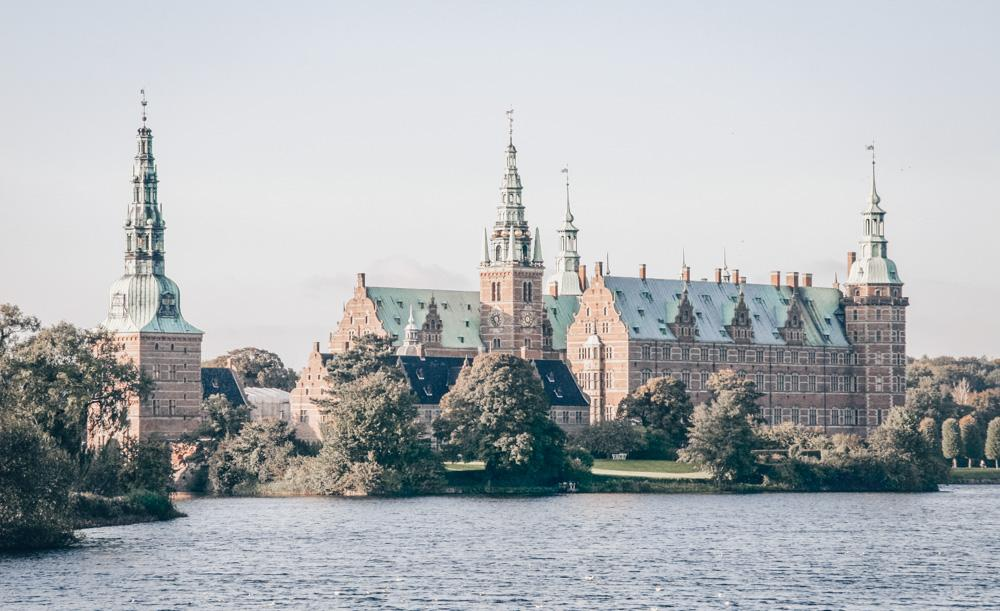 Day Trips from Copenhagen: The elegant Renaissance exterior of Frederiksborg Castle and the surrounding lake