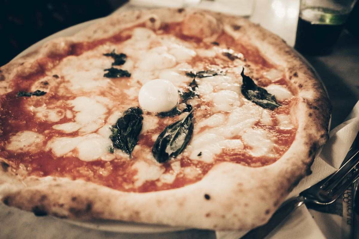 Best Pizza Naples: The classic Pizza Margherita topped with basil and buffalo mozarella