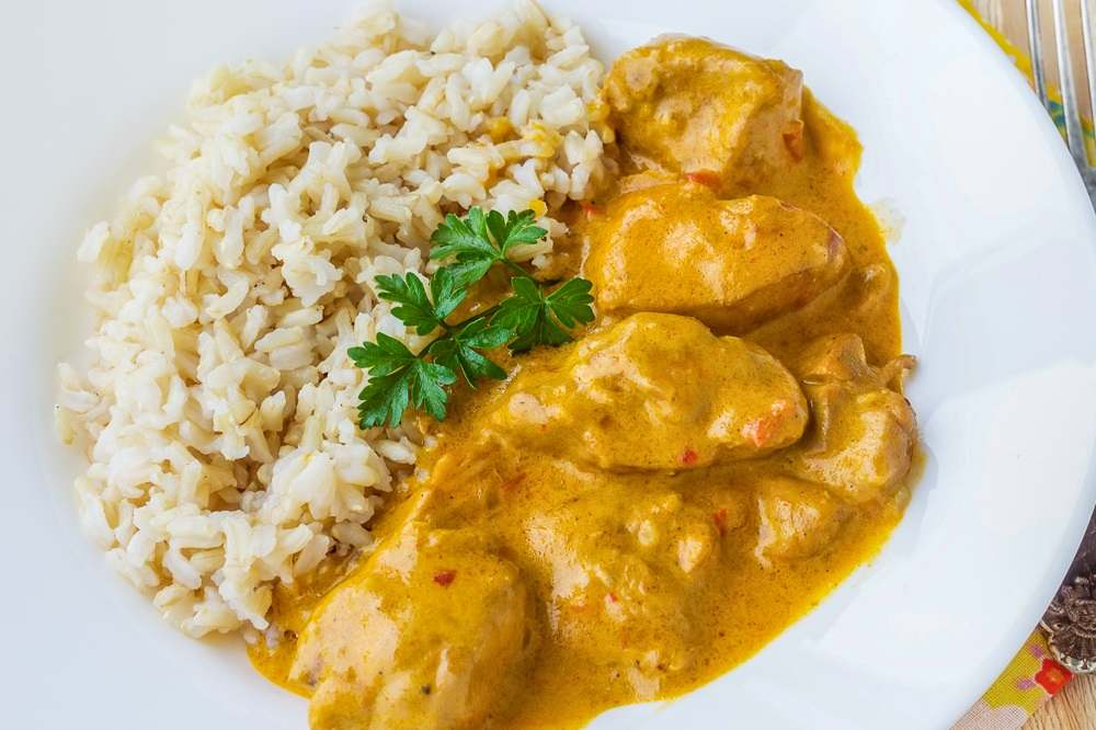 What to eat in Budapest: The scrumptious and juicy Chicken Paprikash is one of the best traditional foods to eat when spending 24 hours in Budapest.