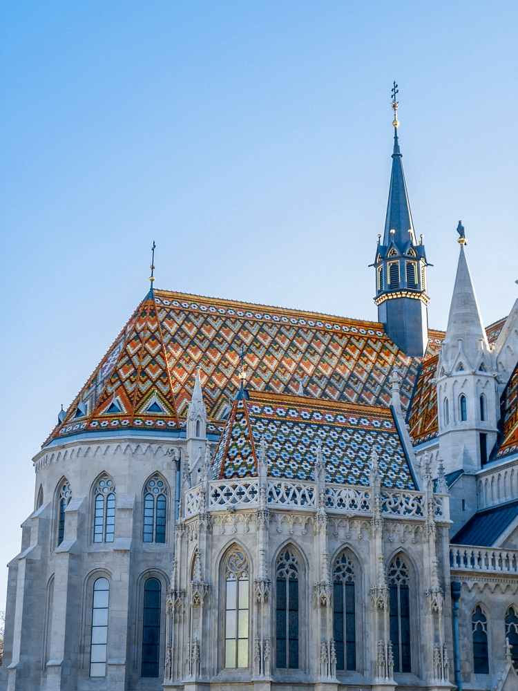 Best things to do in Budapest: The exterior of the famous Matthias Church which is adorned with colorful Zsolnay tiles is one of the best things to see when spending one day in Budapest.
