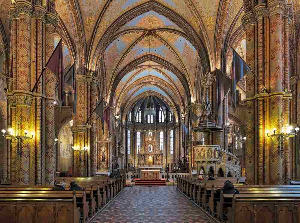 Budapest sightseeing: The glorious colorful patterns, frescoes, and the magnificent stained-glass windows of the interior of the Matthias Church is one of the best things to see when spending one day in Budapest. C: Mikhail Markovskiy/shutterstock.com
