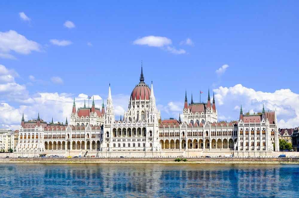 What to see in Budapest - The iconic Hungarian Parliament Building situated along the banks of the Danube River is one of the best things to see when spending one day in Budapest.