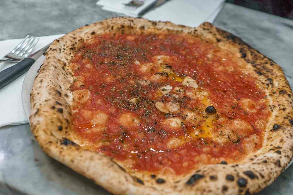 Da Michele only serves traditional Neapolitan pizza.