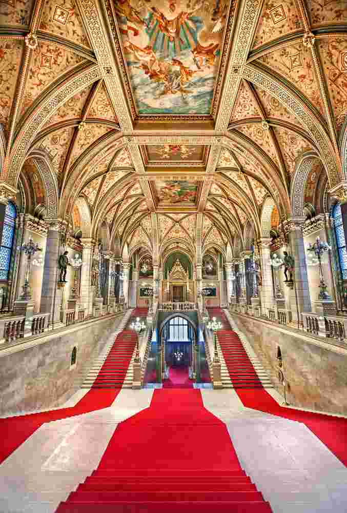 The elegant Grand Staircase of the Parliament Building is one of the best things to see when spending two days in Budapest. C: Heracles Kritikos/shutterstock.com