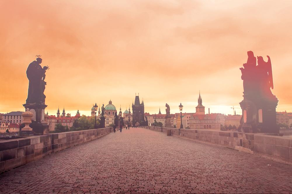 y in Prague with catching the sunrise over Charles Bridge.