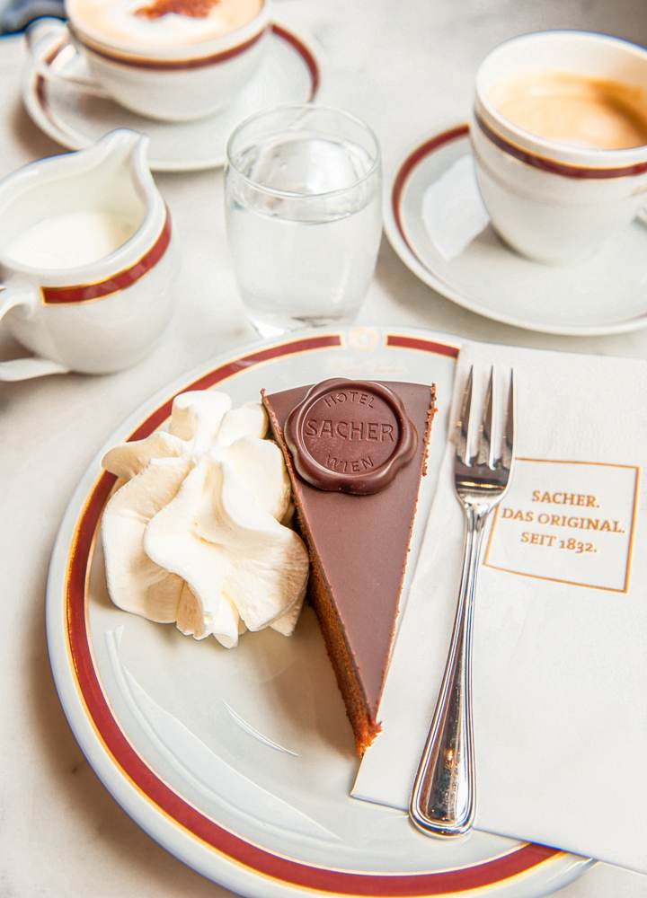 Finish of this self-guided walking tour of Vienna with a nice piece of Sacher cake. C: Elena Pominova / Shutterstock.com