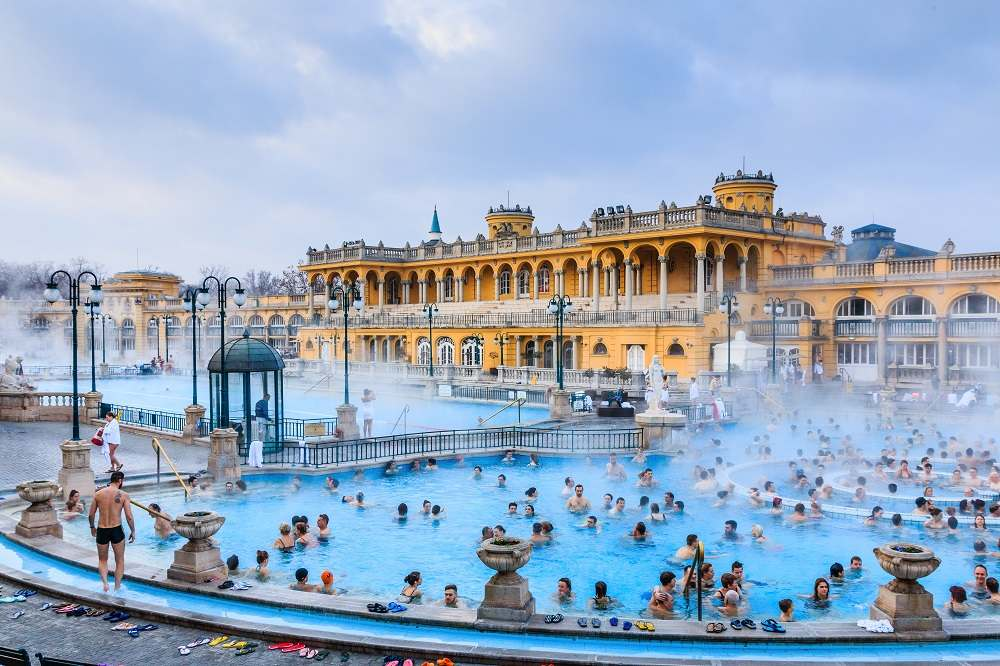 Relaxing at the famous Szechenyi Thermal Baths is one of the top things to do when spending 48 hours in Budapest. C: Izabela23/shutterstock.com