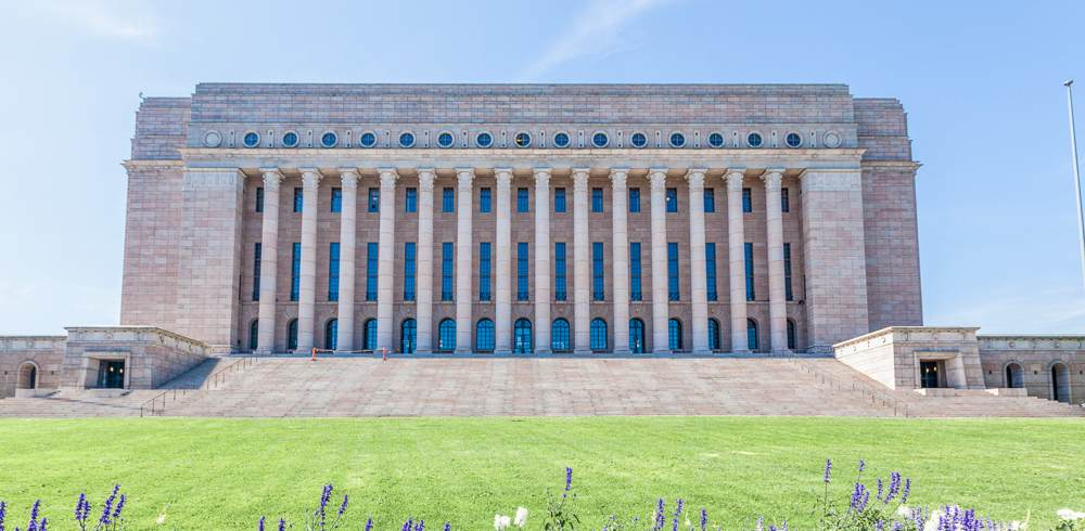 The imposing Finnish Parliament Building is one of the must see attractions on this free self-guided Helsinki walking tour.
