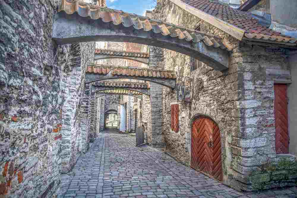 A walk through the atmospheric cobblestone St. Catherine's Passage is one of the top things to do when spending 24 hours in Tallinn.