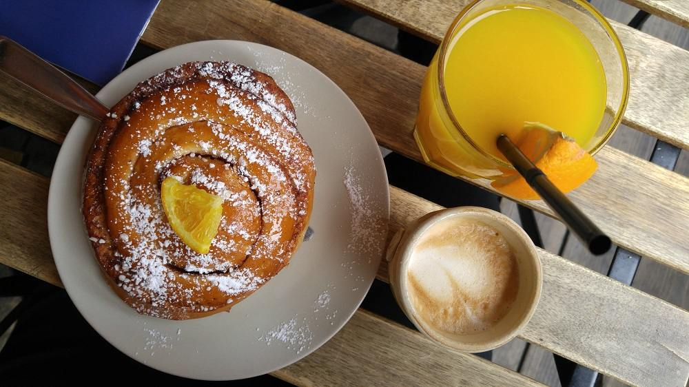 Trying a cinnamon bun with coffee is one of the essential Finnish experiences during a weekend in Helsinki.