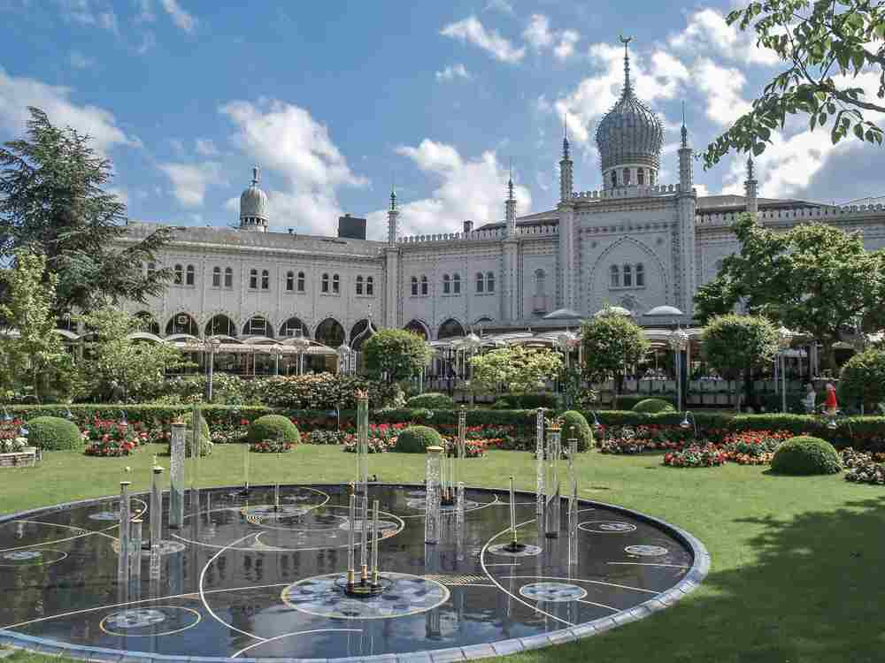 As your one day in Copenhagen comes to an end, head over to Tivoli Gardens.
