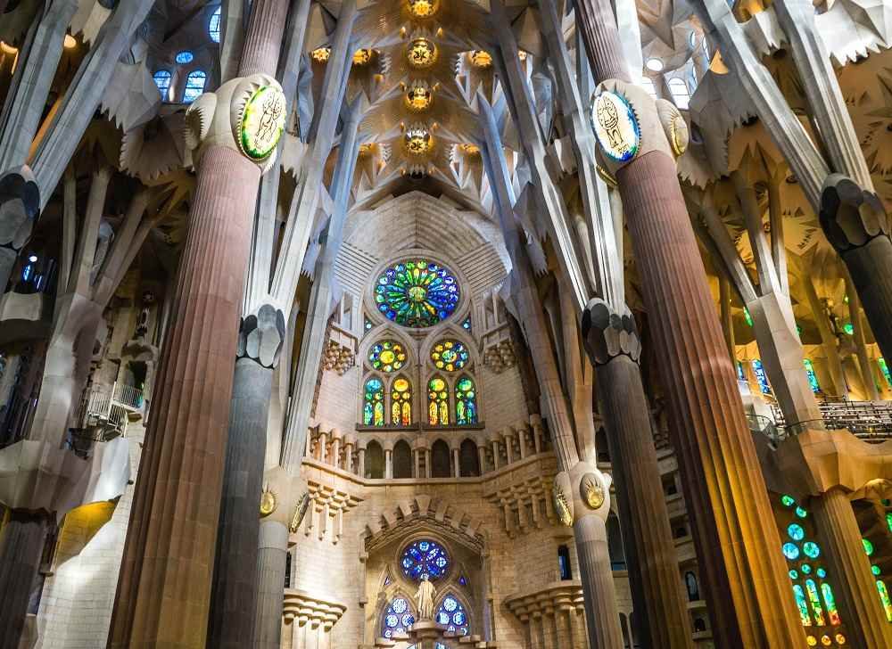 Best cities to see Art Nouveau architecture in Europe: The jaw-dropping interior of the Sagrada Familia in Barcelona is one of the best examples of Art Nouveau architecture in the world.
