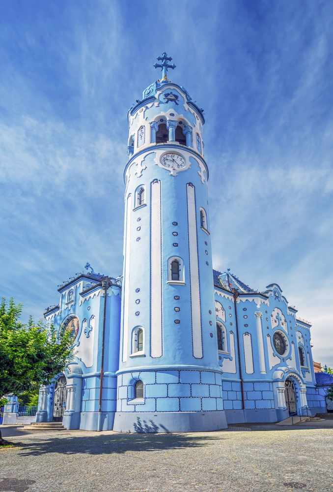Must visit places in Bratislava: The eye-catching Art Nouveau style Blue Church is completely painted in blue and features lovely motifs.