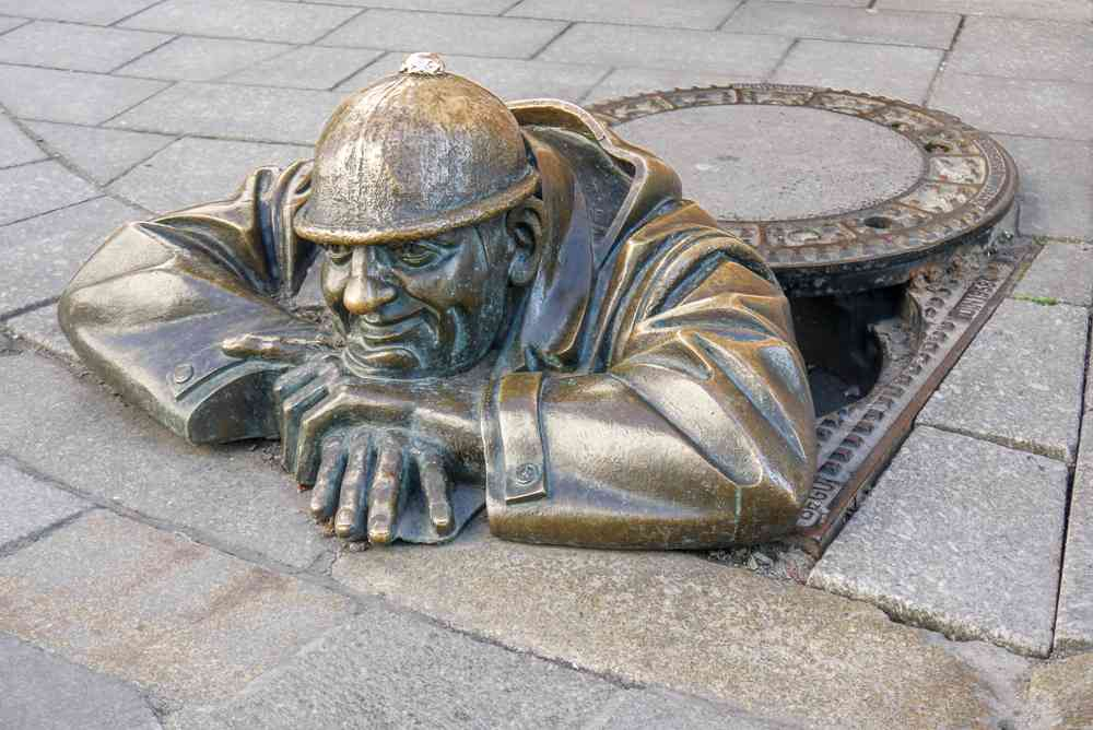 What to do in Bratislava: The iconic Cumil statue in the Old Town is one of the must-see attractions in Bratislava.