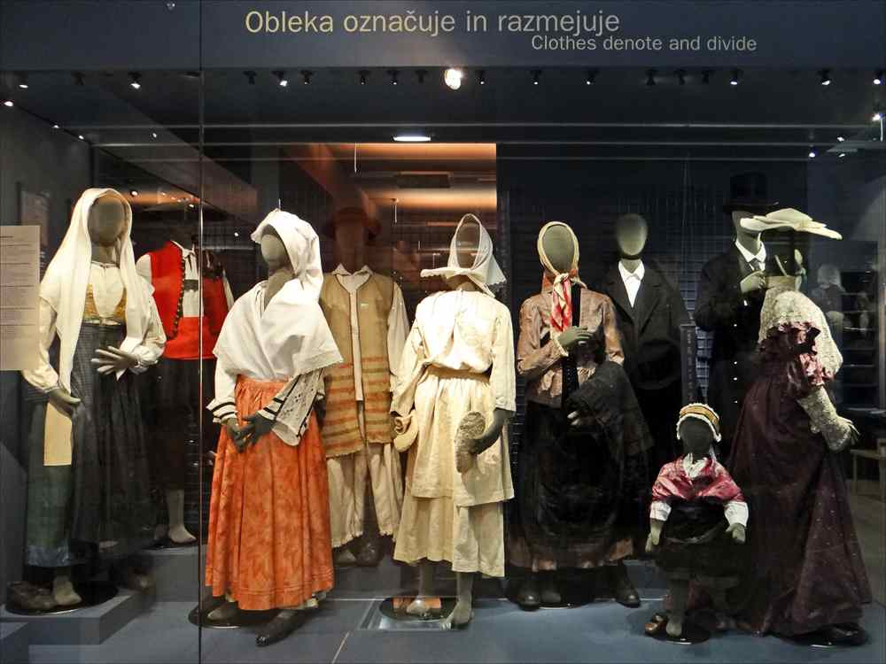 One Day in Ljubljana itinerary: The traditional folk costumes on display at the Slovene Ethnography Museum are one of the best things to see when visiting Ljubljana. Photo Credit: dalbera from Paris, France, Musée dethnographie slovène (Ljubljana) (9426690519), [CC BY 2.0 (https://creativecommons.org/licenses/by/2.0)], via Wikimedia Commons.