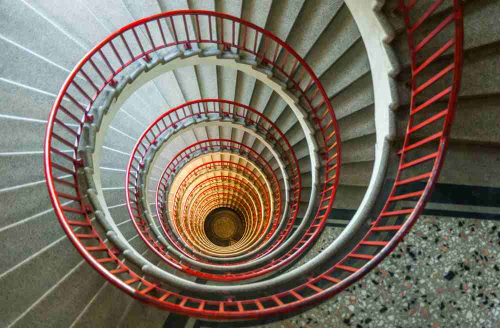 One day in Ljubljana itinerary: Don't forget to check out the lovely snail staircase of the iconic Neboticnik building.