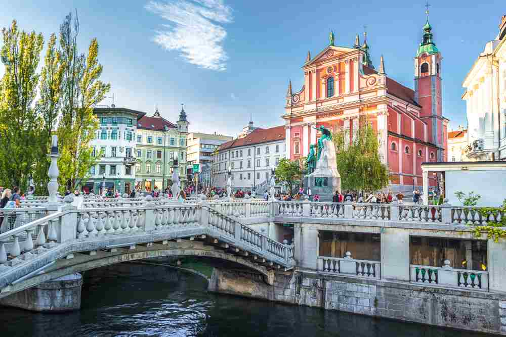Things to do in Ljubljana: The iconic Triple Bridge in the Old Town is one of the must-see attractions when sightseeing in Ljubljana for one or two days.