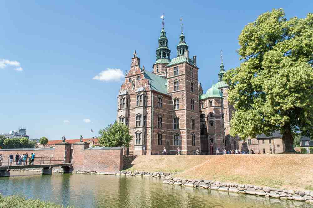 Relaxing at Kongens Have with a view of Rosenborg Castle is one of the best free things to do in Copenhagen.