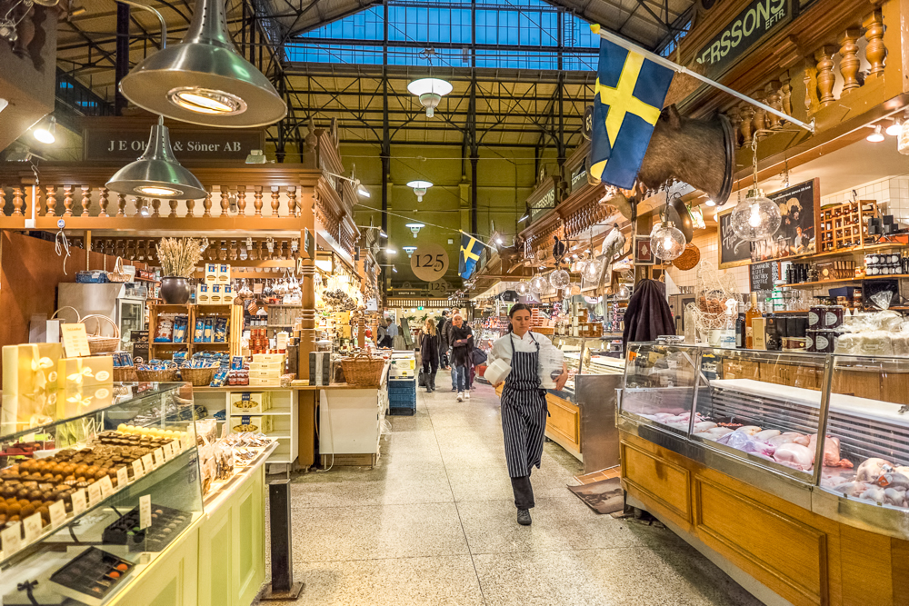 Where to eat in Stockholm: The top-notch Östermalm Food Hall features a wide variety of restaurants and is one of the best places to eat in Stockholm. C: Rolf_52/shutterstock.com