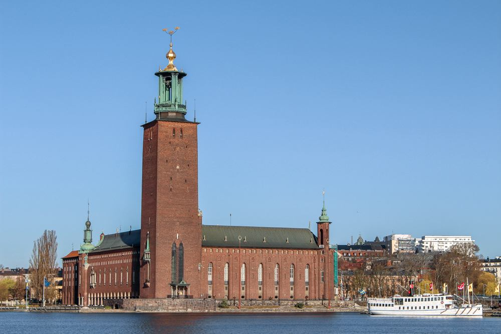 3 Days in Stockholm: View of Stockholm City Hall from the water, it is one of the must see attractions in Stockholm.