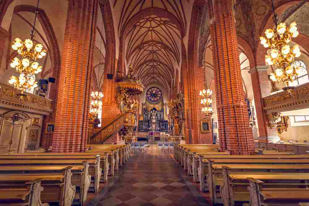 What to do in Stockholm: The stunning Gothic interior of the Stockholm Cathedral features a metal statue of St. George & the Dragon and is a must-see when spending 3 days in Stockholm.
