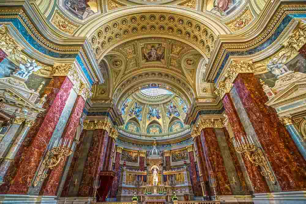 What to see in Budapest: The opulent interior of the St. Stephen's Basilica is beautifully adorned with frescoes, stained glass windows. It is one of the best places to visit when spending one day in Budapest. C: Luciano Mortula - LGM/shutterstock.com