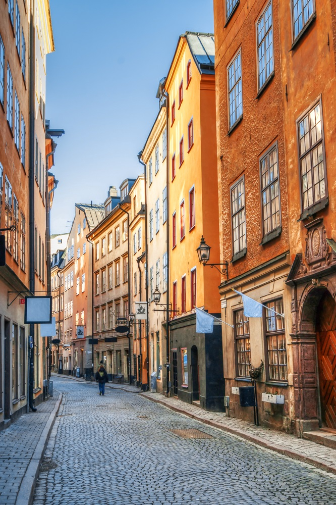 What to see in Stockholm: The colorful houses and antique shops on Österlånggatan are one of the must-see attractions when spending 24 hours in Stockholm.