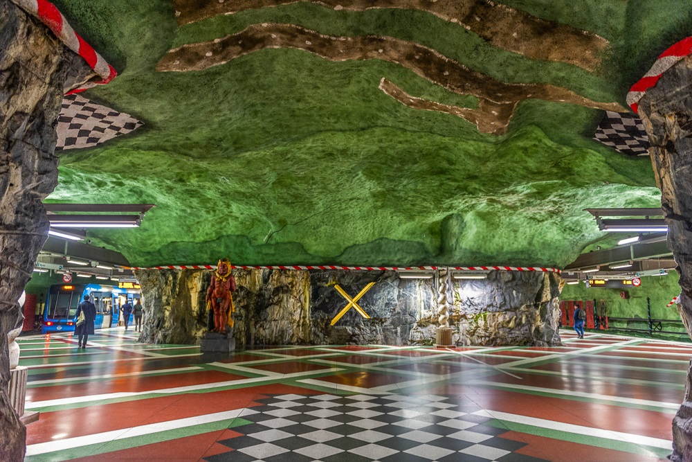 One Day in Stockholm: The amazing Kungsträdgården metro station resembles an underground garden and segments of its exposed bedrock are decorated with colorful mosaics. It is one of the must-see sights in Stockholm. C: yakub88/shutterstock.com