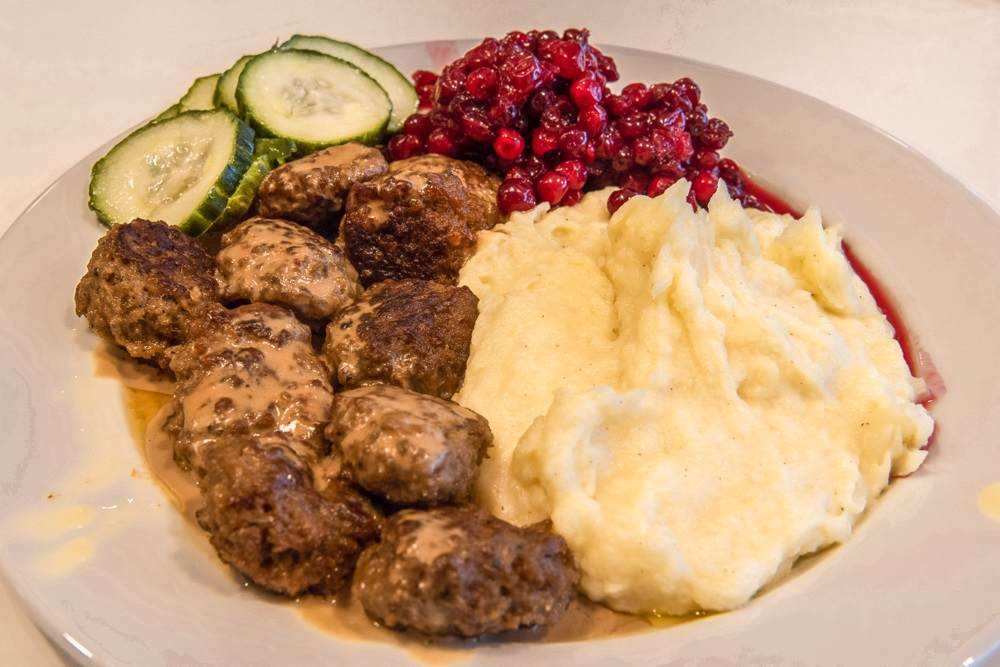 What to eat in Stockholm: When spending one day in Stockholm, you should definitely try traditional Swedish meatballs with mashed potatoes and lingonberry jam.