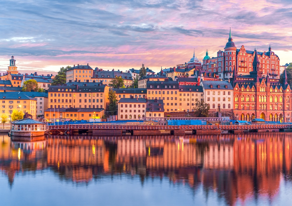 Best Places to visit in Stockholm: Beautiful evening sunset scenery of the craggy cliffs, turrets and towers of Södermalm, one of the must-see attractions when spending one day in Stockholm.