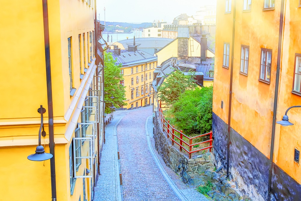 One Day in Stockholm: The narrow cobblestone street Bastugatan in Södermalm with medieval houses in Stockholm one a sunny summer day.