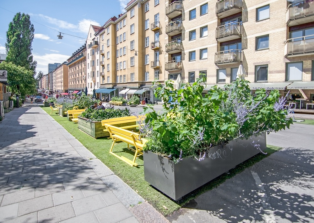 Stockholm Neighborhoods: Cafes, people and beautiful buildings around trendy Lilla Nytorget, one of the best places to see in Södermalm when spending 24 hours in Stockholm. C: Artesia Wells/shutterstock.com