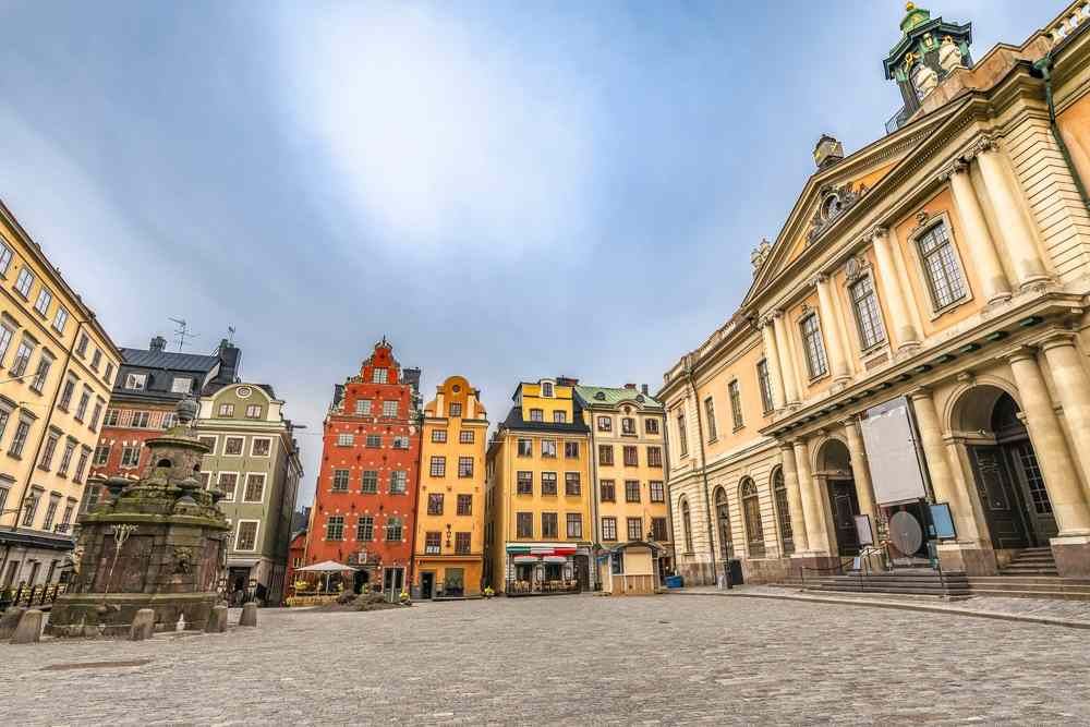 24 Hours in Stockholm: Stortorget is the main square in Gamla Stan that is surrounded by colorful patrician houses with curling gables and the beautiful Nobel Museum and is one of the best places to visit in Stockholm.