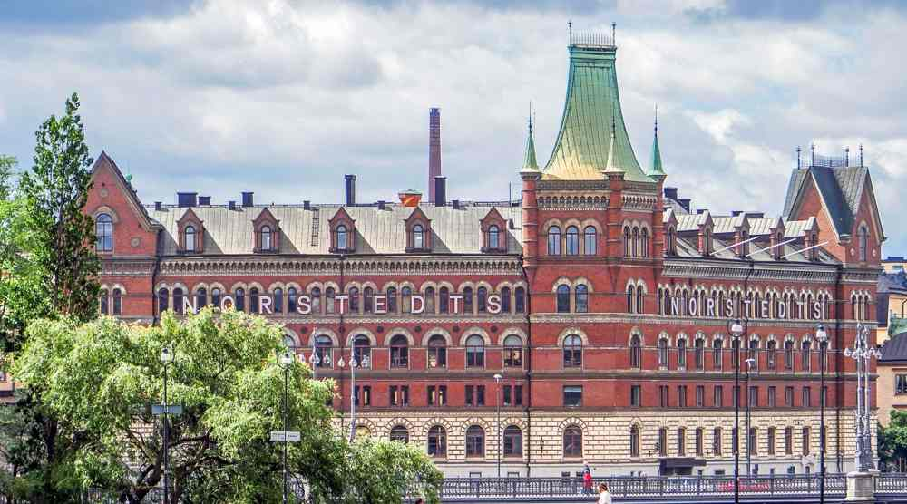 Free Self-Guided Stockholm Walking Tour: The attractive Norstedts building is one of the best known landmarks in Stockholm.