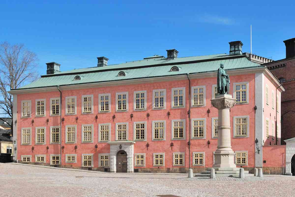 The elegant pink facade of the historic Stenbock Palace is one of the highlights of this free self-guided Stockholm walking tour.