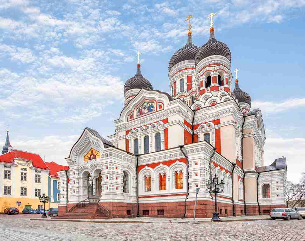 Tallinn Churches: The Alexander Nevsky Cathedral's striking Neo-Byzantine exterior is richly decorated in mosaics and icons and its bulging black domes and golden iron crosses are major landmarks in the Old Town of Tallinn. It is undoubtedly one of the best places to see on a Tallinn walking tour.