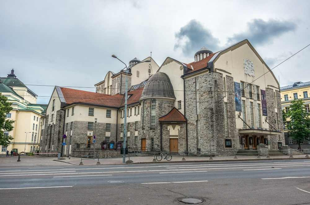 Best places to see in Tallinn: The wonderful Estonian Drama Theater building blends Art Nouveau with Nordic folk motifs and its roofs resemble the shingles of village huts. It is one of the best things to see when on a Tallinn walking tour. C: Igor Dymov/shutterstock.com