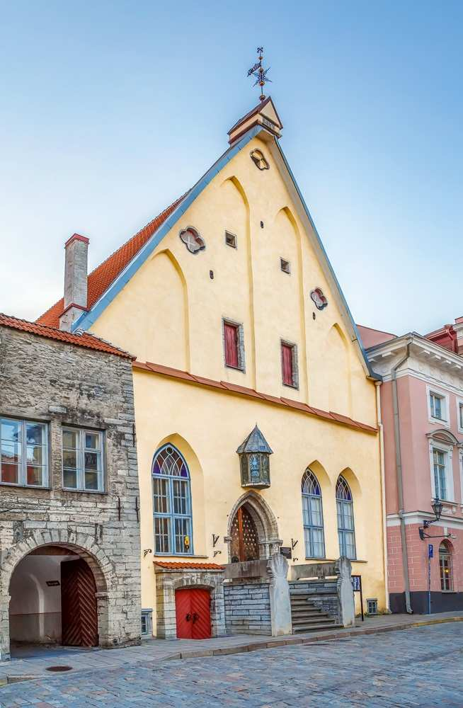 Tallinn walking tour: The 15th century Gothic building of the Great Guild has retained its original appearance through the centuries and is one of the best places to visit in Tallinn.