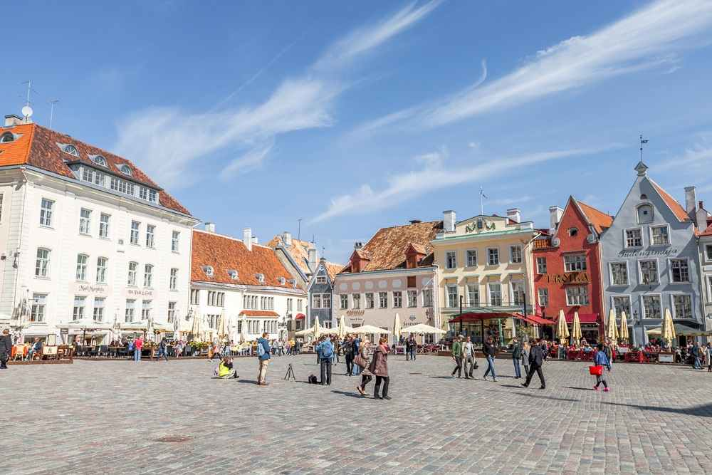 Best things to see in Tallinn: The enchanting Town Hall Square is a cobblestoned square that is surrounded by an ensemble of pastel-colored medieval houses making it one of the must-see attractions on a walking tour of Tallinn. C: Evannovostro/shutterstock.com
