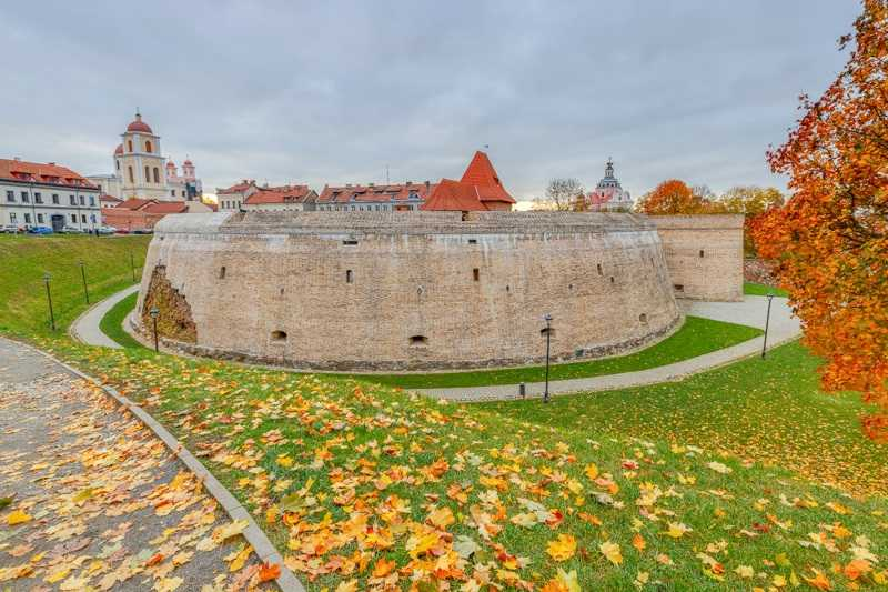 Free Self-Guided Vilnius Walking Tour: The semicircular red-brick cannon fortification of the Artillery Bastion is one of the best things to see in Vilnius.