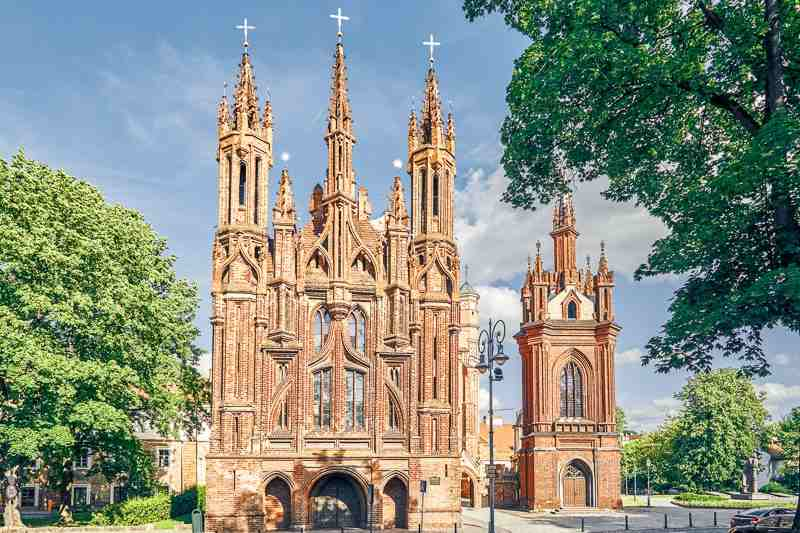 Vilnius Churches: The fairytale, pinnacle encrusted towers of the flamboyant Gothic style Church of St. Anne is one of the best things to see in Vilnius.