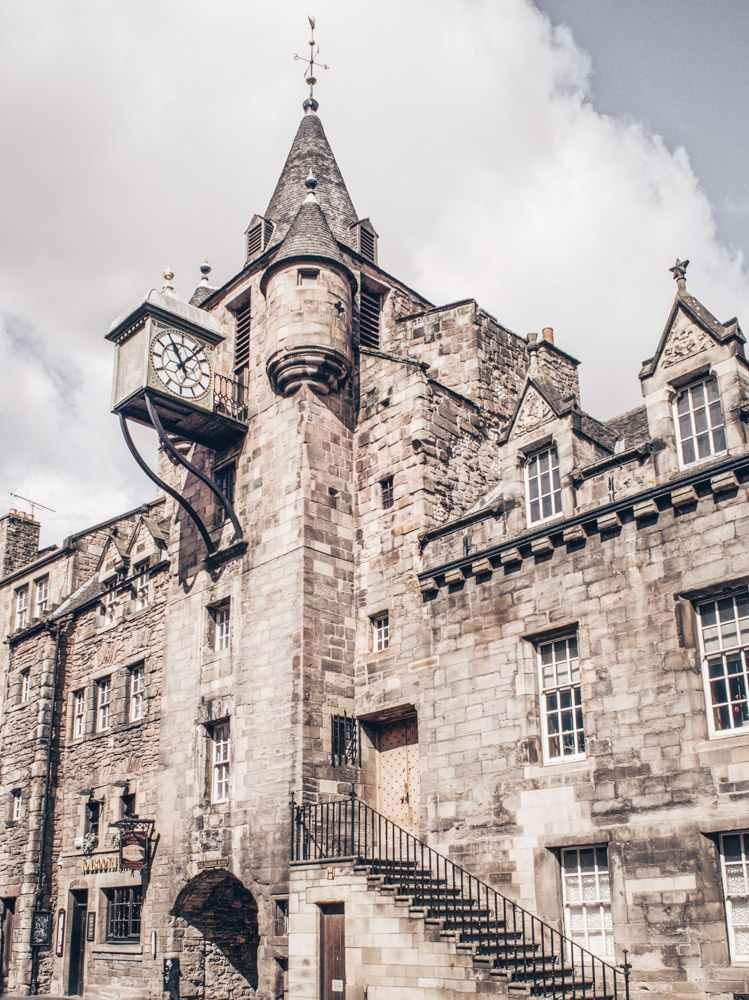 Things to see in Edinburgh: View of the turreted steeple and box clock of the 16th century Canongate Tolbooth, one of the highlights of this self-guided walking tour of Edinburgh.