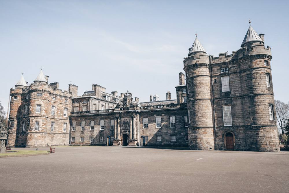 Free Self-guided Edinburgh walking tour: The Palace of Holyroodhouse, Queen Elizabeth II's official Scottish residence, is one of the best things to see in Edinburgh.