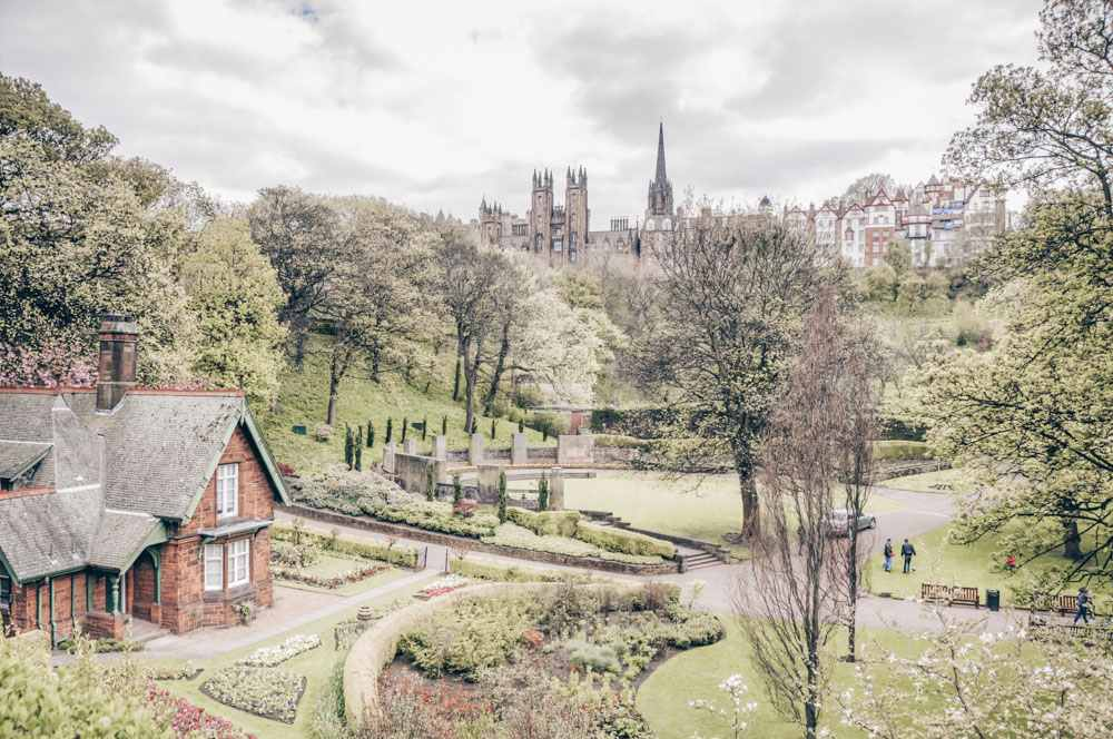 What to do in Edinburgh: View of the Princes Street Gardens, one of the best things to see in Edinburgh while taking a walking tour of the city.